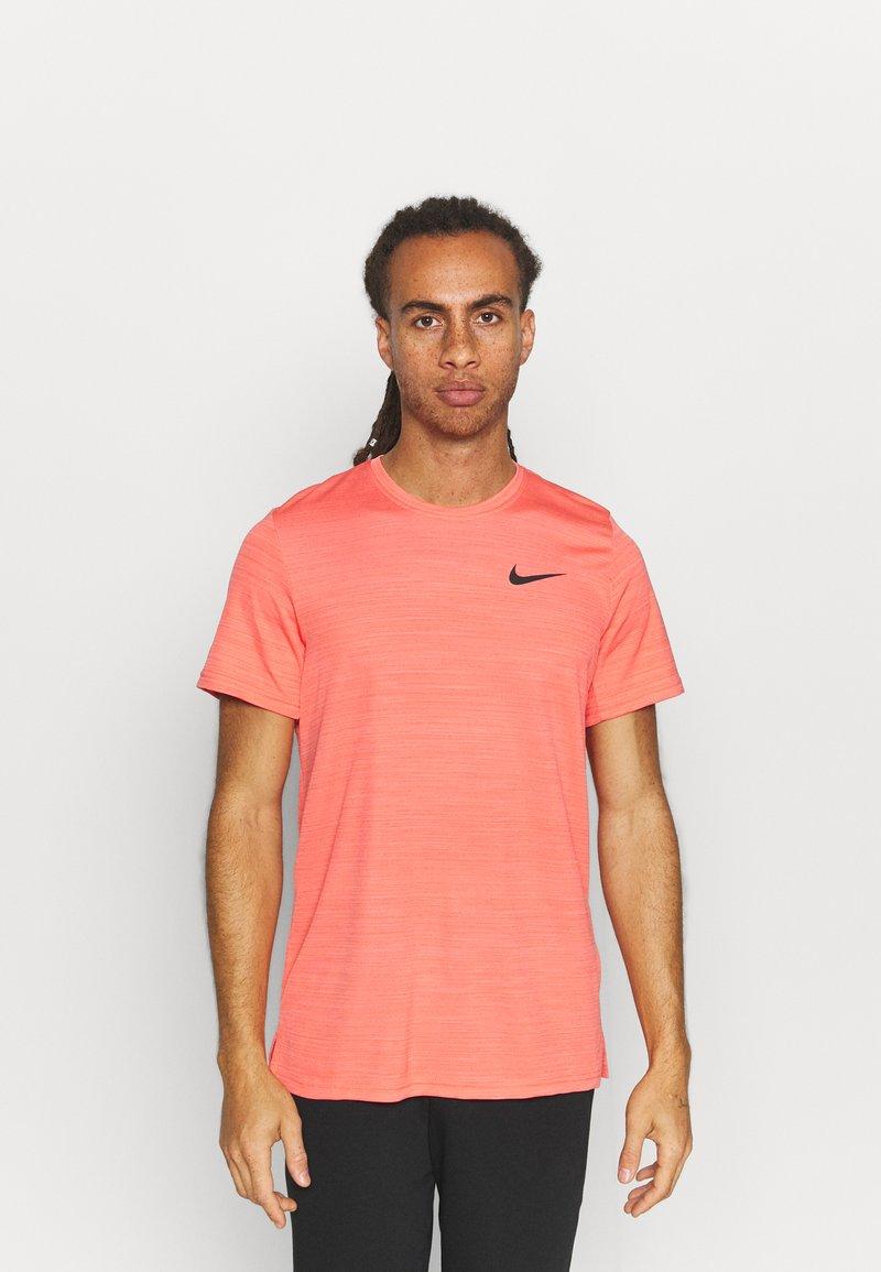 Nike Performance - DRY SUPERSET - T-shirt - bas - magic ember/black