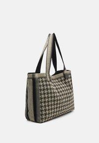 CECILIE copenhagen - BAG LARGE DOGTOOTH - Shopping bag - black/cream - 1