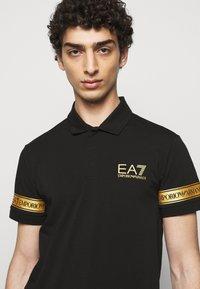 EA7 Emporio Armani - Polo shirt - black gold - 3