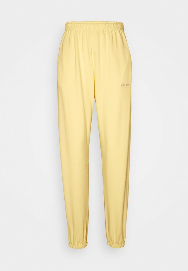 ZIA PANTS  - Tracksuit bottoms - yellow