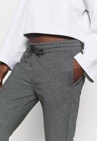 adidas Performance - PANT - Tracksuit bottoms - mottled dark grey - 3