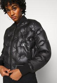 Diesel - W-AVALES JACKET - Down jacket - black - 5