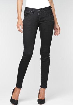 NIKITA - Slim fit jeans - black