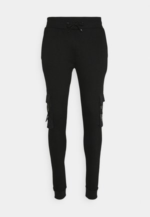 CHELSEA - Tracksuit bottoms - black