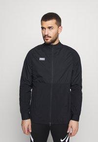 Nike Performance - Training jacket - black/black/white/clear - 0
