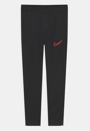 ACADEMY PANT UNISEX - Pantalon de survêtement - black/bright crimson