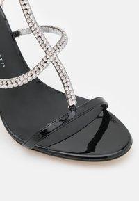 Giuseppe Zanotti - High heeled sandals - tinta passante/nero - 6