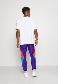 NAUTICA COMPETITION - LASTAGE - Pantalones deportivos - purple - 2