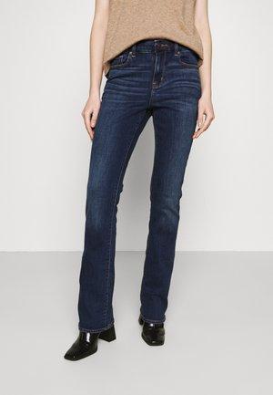 CURVY KICK - Flared Jeans - dark ink