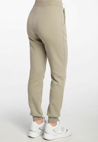 Guess - ABBY LONG  - Tracksuit bottoms - beige - 2