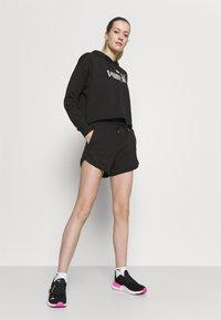 Puma - MODERN BASICS  - Pantalón corto de deporte - black - 3