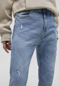 PULL&BEAR - Jeans Tapered Fit - mottled dark blue - 3