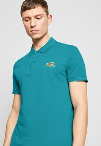 Lacoste - PH5144 - Polo shirt - turquoise - 5