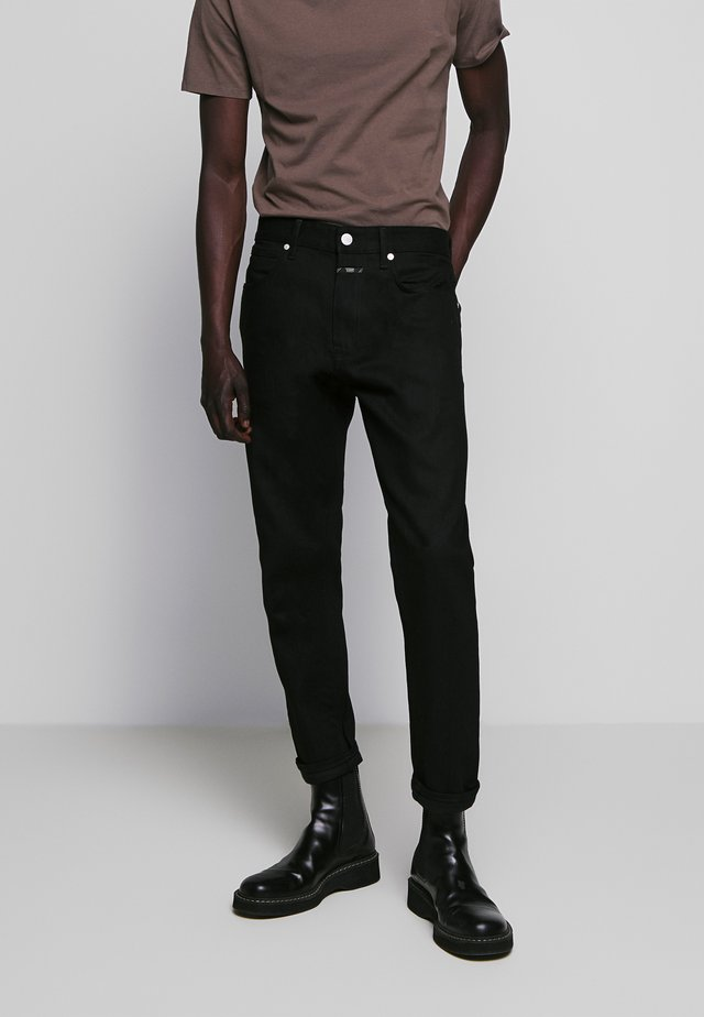 COOPER - Vaqueros slim fit - black