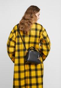 DKNY - SATCHEL - Handbag - black/gold - 1