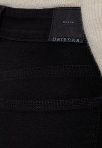 Bershka - MIT HOHEM BUND  - Jeans Skinny Fit - black - 4