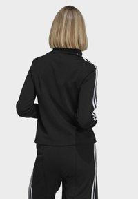 adidas Originals - ORIGINALS PRIMEBLUE TRACK SLIM - Giacca sportiva - black - 1