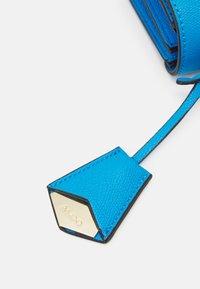 ALDO - CRIWIEL - Across body bag - diva blue/gold-coloured - 4