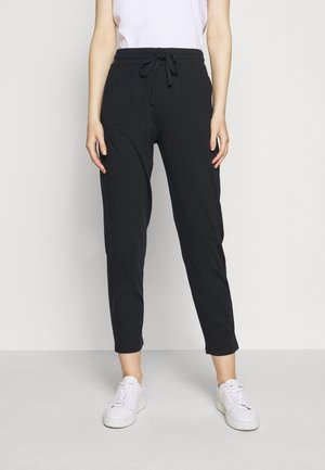 KERAS - Tracksuit bottoms - black