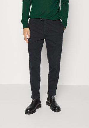 ROWAN - Trousers - black