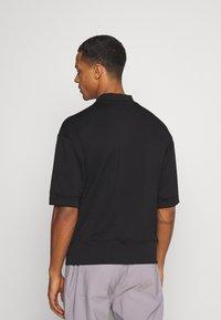 Sixth June - HIGH NECK OVERSIZED TEE - T-shirt - bas - black - 2
