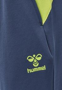 Hummel - HMLLEAD  - Tracksuit bottoms - dark denim - 4