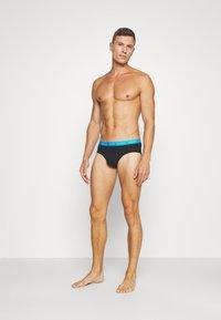 Calvin Klein Underwear - DAYS OF THE WEEK HIP BRIEF 7 PACK - Briefs - black - 0