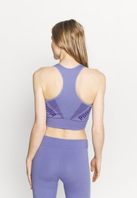 Puma - EVOSTRIPE BRA - Light support sports bra - hazy blue - 2