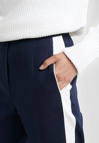 HUGO - HERANI - Trousers - open blue - 4
