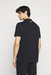 Lacoste - Polo shirt - abimes - 2