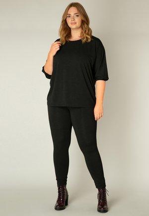ANDREA ESSENTIAL - Leggings - Trousers - black melange