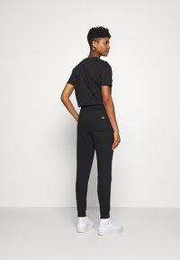 Tommy Jeans - TOMMY CLASSICS - Spodnie treningowe - black - 2