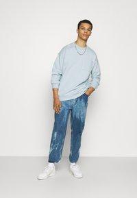 YOURTURN - UNISEX - Sweatshirt - light blue - 1