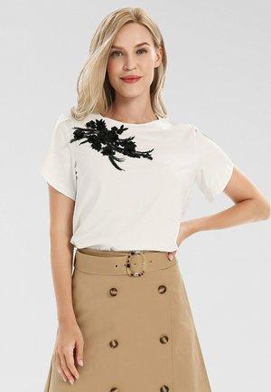 T-shirt imprimé - creme-schwarz