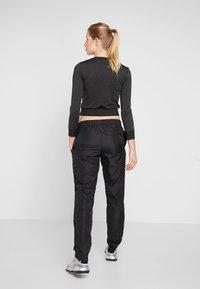 Puma - WARM UP PANT - Pantalones deportivos - puma black - 2