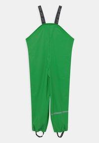 CeLaVi - RAINWEAR PANTS  RAINWEAR UNISEX - Rain trousers - green - 1