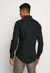 Calvin Klein Tailored - STRETCH SLIM - Chemise classique - black - 2