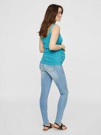 MAMALICIOUS - Slim fit jeans - light blue denim - 3