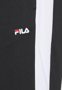Fila - SANDRO TRACK PANT - Träningsbyxor - black-bright white - 4