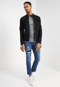 Tigha - BUFFED - Leather jacket - black - 1