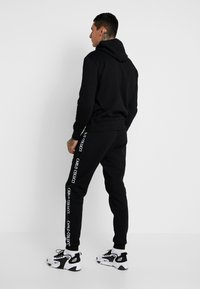 Carlo Colucci - Tracksuit bottoms - schwarz - 2