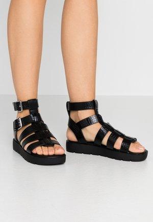 GLASSY - Sandály na platformě - black