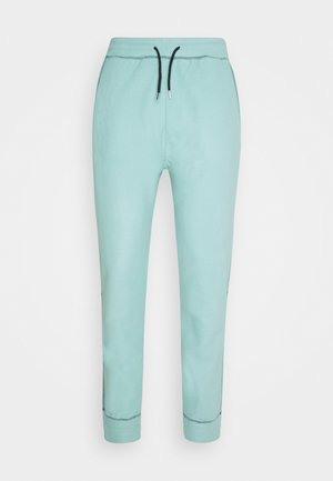 CONTRAST STITCH JOGGER UNISEX - Tracksuit bottoms - dusty mint