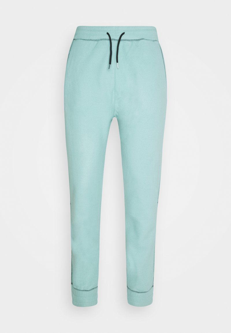 Mennace - CONTRAST STITCH JOGGER UNISEX - Tracksuit bottoms - dusty mint
