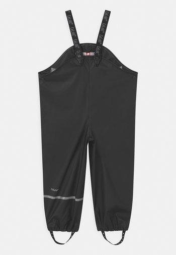 RAINWEAR PANTS  RAINWEAR UNISEX - Rain trousers - black