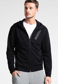 Puma - BONDED TECH  - Fleece jacket - black - 0