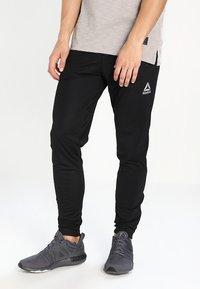 Reebok - TRAINING TRACK PANTS - Tracksuit bottoms - black - 0