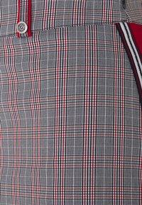 Golfino - CLUB CHECKED SKORT - Sports skirt - red flame - 2