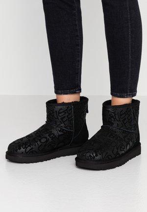 CLASSIC MINI SPARKLE GRAFFITI - Classic ankle boots - black