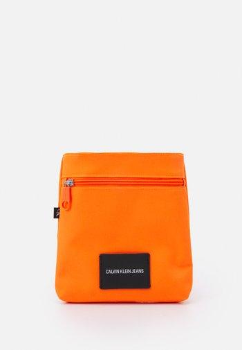 MICRO FLATPACK UNISEX - Across body bag - vivid orange